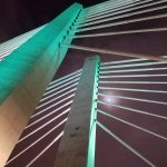 tilikum crossing bridge architecture with full moon peering through