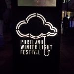 portland winter light festival logo rain cloud and umbrella handle
