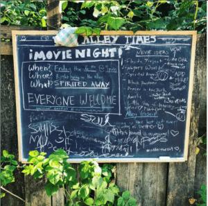 chalkboard of the neighborhood movie schedule